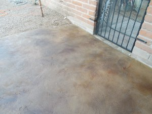 Stained Decorative Concrete Patio Overlay by Arizona Concrete Designs, LLC www.arizonaconcretedesigns.com - Stained concrete overlay in medium and dark brown finish in Tucson, AZ. Call us today for a free estimate at 520-338-7503.