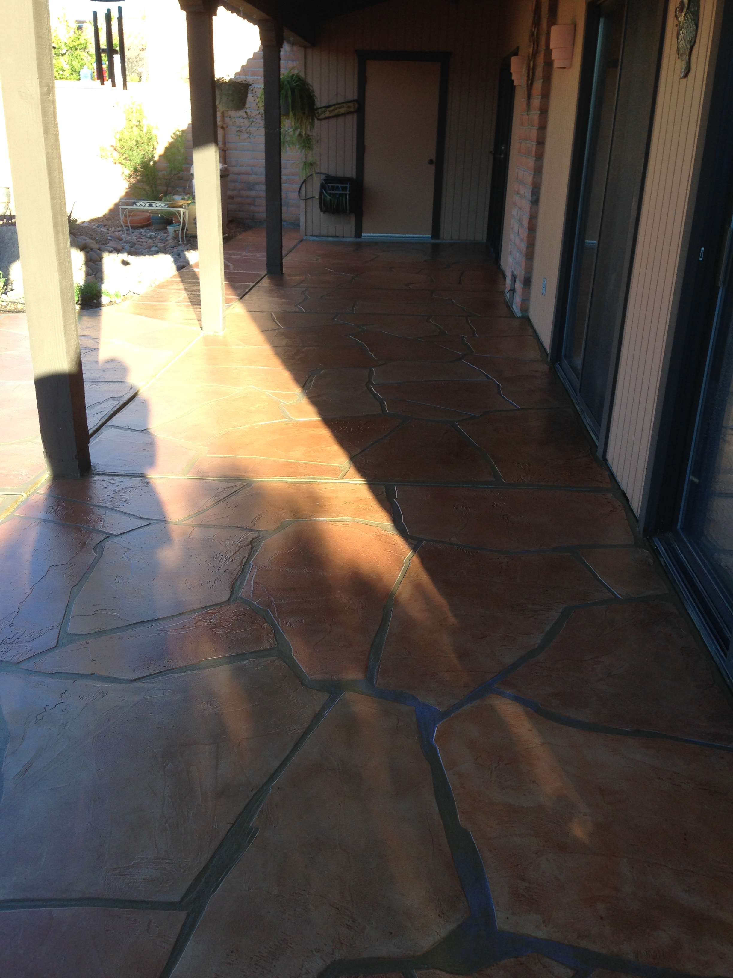 Decorative concrete flooring overlays arizona concrete for Reseal cork flooring